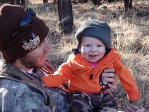 Photo of Dad and Infant Hunters