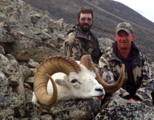 A Photo of a Dall Sheep with Hunters