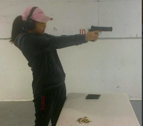Photo of a Woman Shooting a 22 Pistol